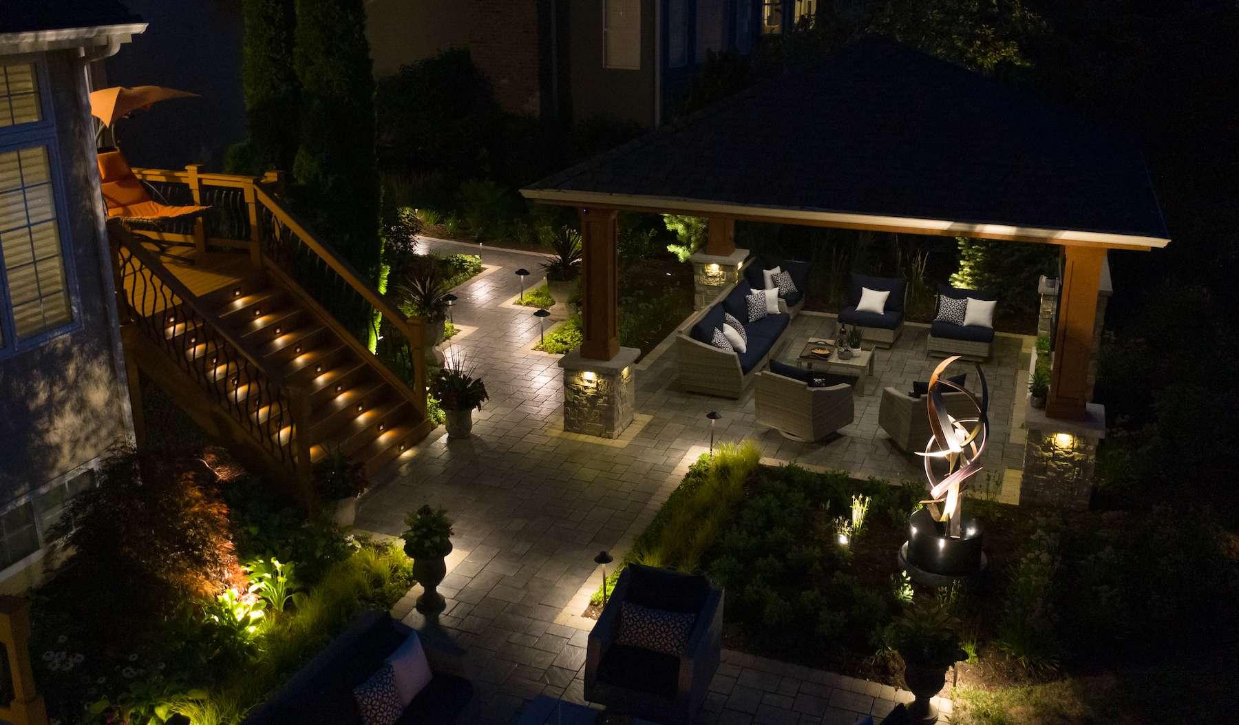 backyard with landscape lighting
