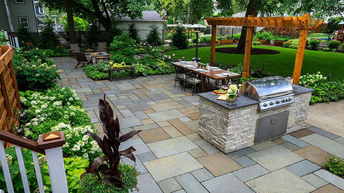 patio dining area and outdoor kitchen landscape design