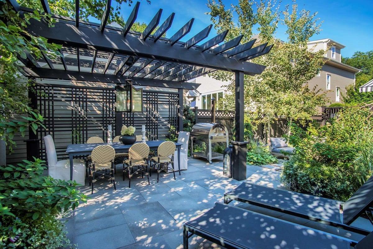pergola above outdoor dining area