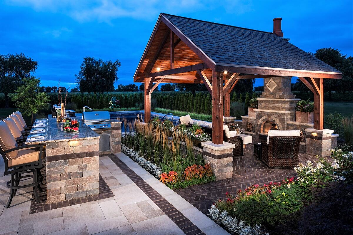 outdoor kitchen and grill with pavilion and fireplace