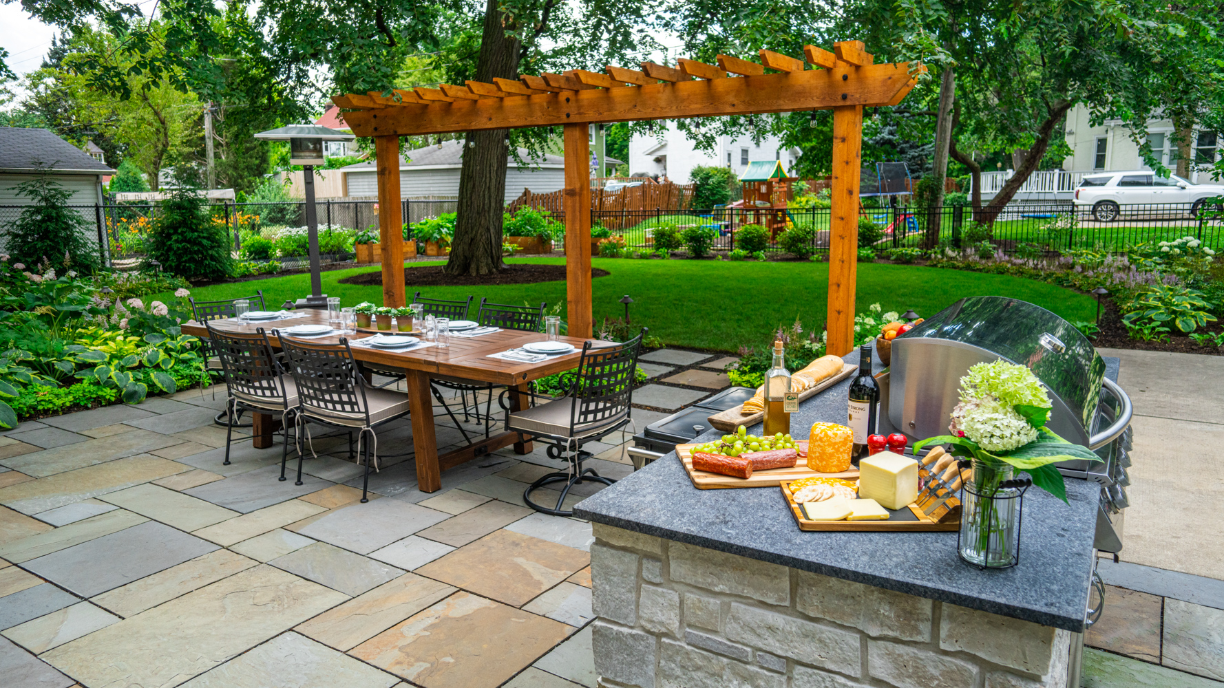 Patio, outdoor kitchen, and yard