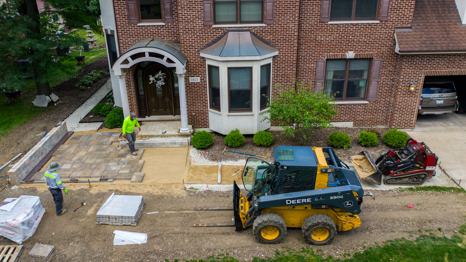 Hardscape installation crews putting in a paver walkway