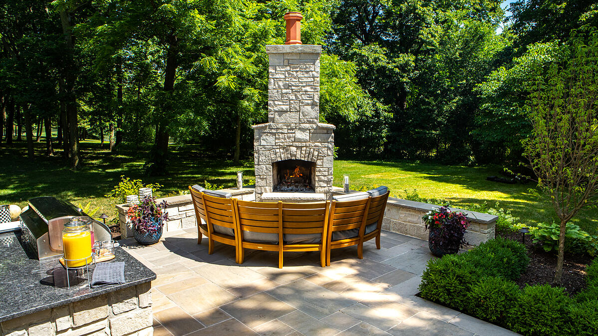 outdoor kitchen with fireplace and patio