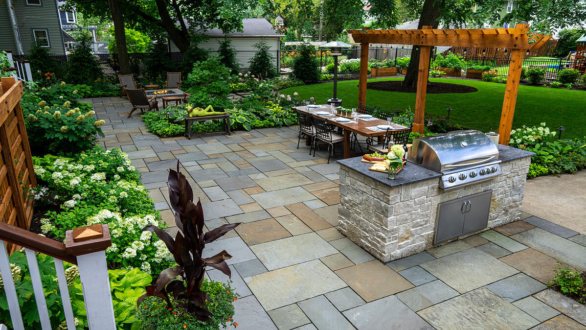Outdoor grill with seating and fire pit