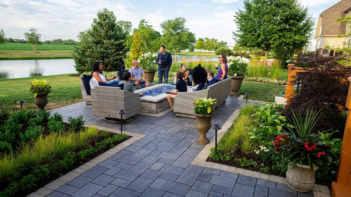 paver patio with contrast edging and fire table