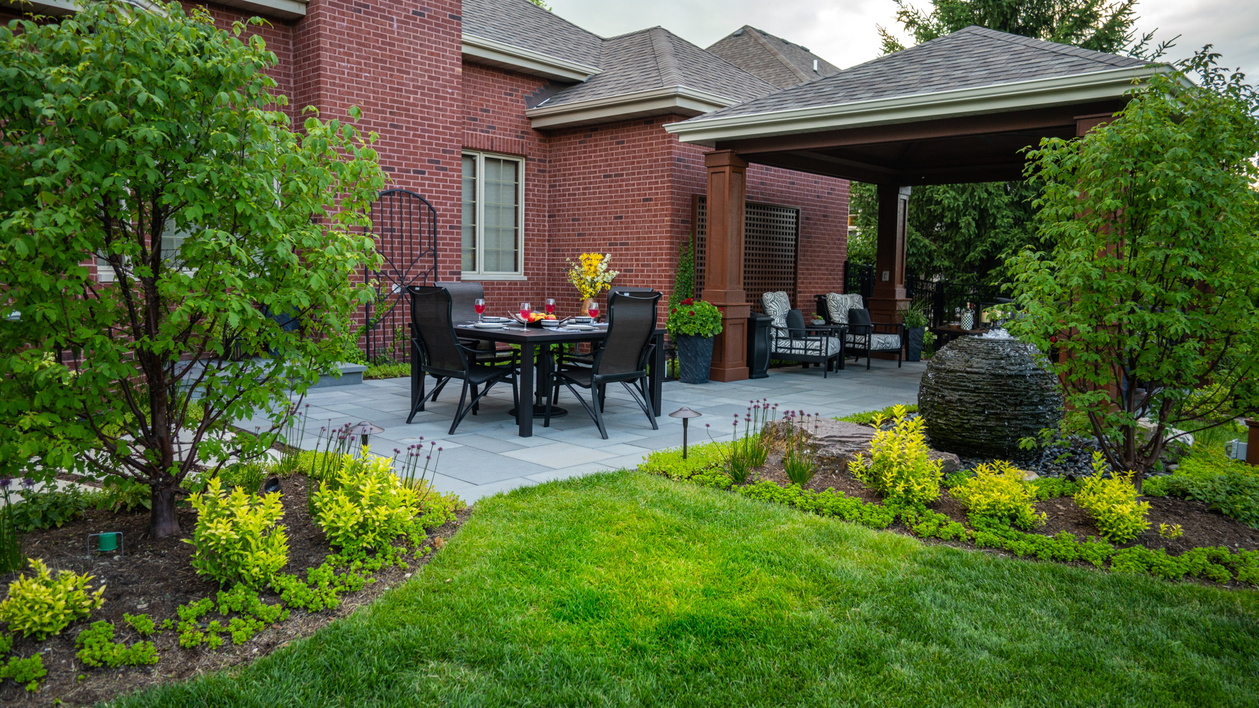 Beautiful patio, lawn, and pavilion