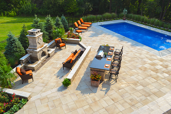 landscape design with fireplace outdoor kitchen and pool