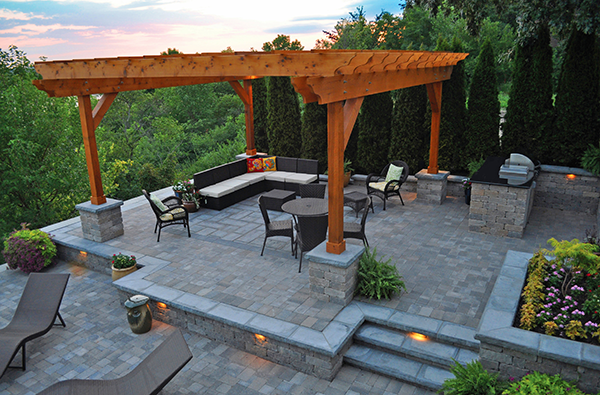 Large pergola over paver patio
