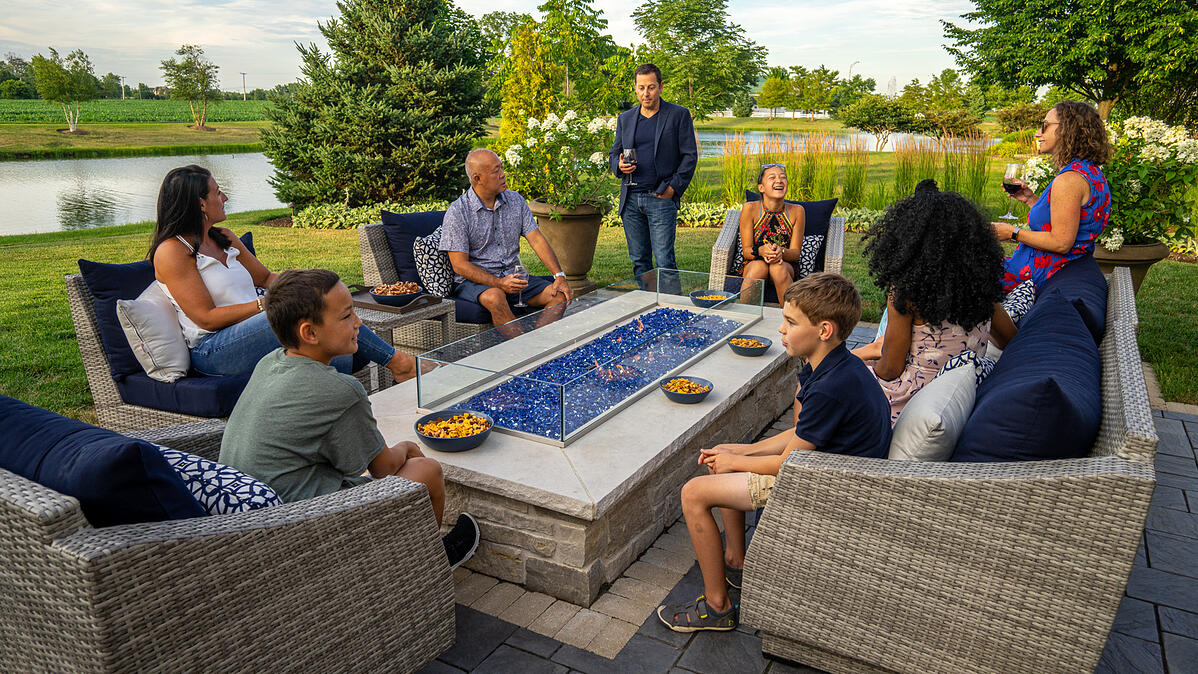 Customers enjoying their gas fire pit with friends