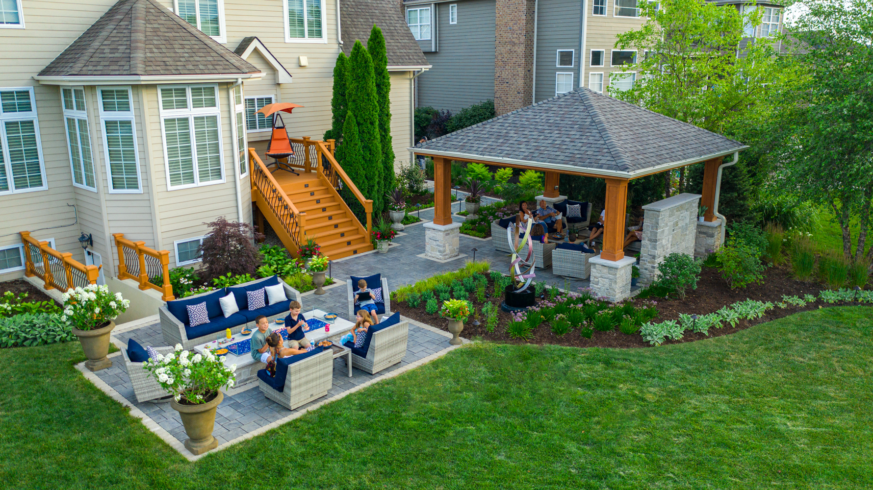 aerial-fire feature-sculpture-pergola-customer-patio-paver-seating-container-landscaping-plants-planting-lawn-steps