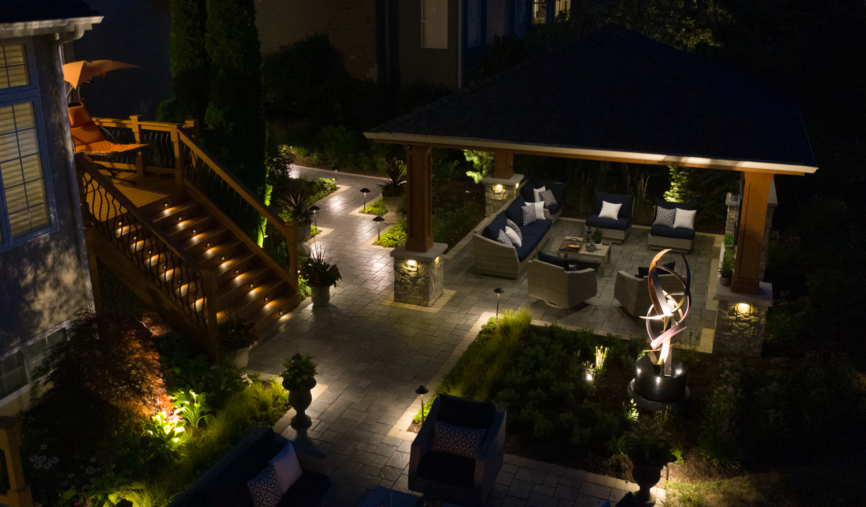 aerial-patio-paver-seating-sculpture-steps-landscaping-lighting-pergola