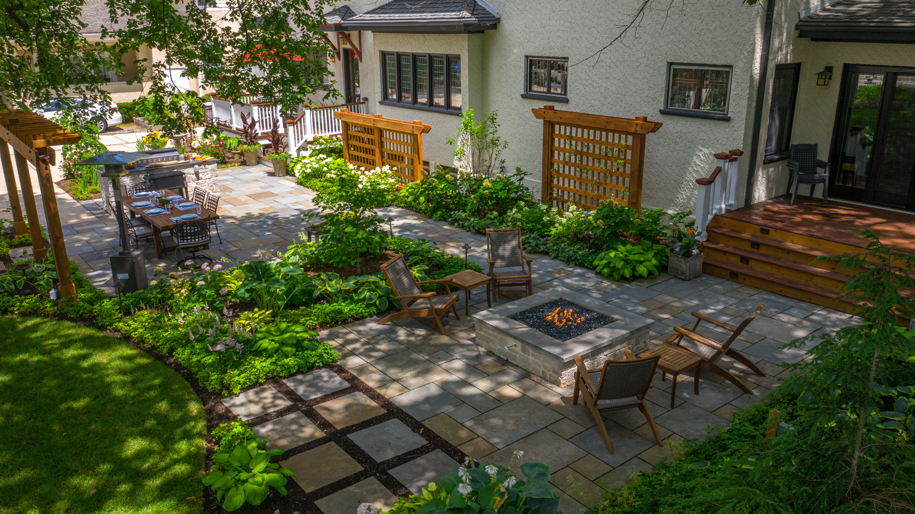 aerial-patio-pavers-trellis-seating-fire feature-steps-outdoor kitchen-arbor-planting-plants-lawn