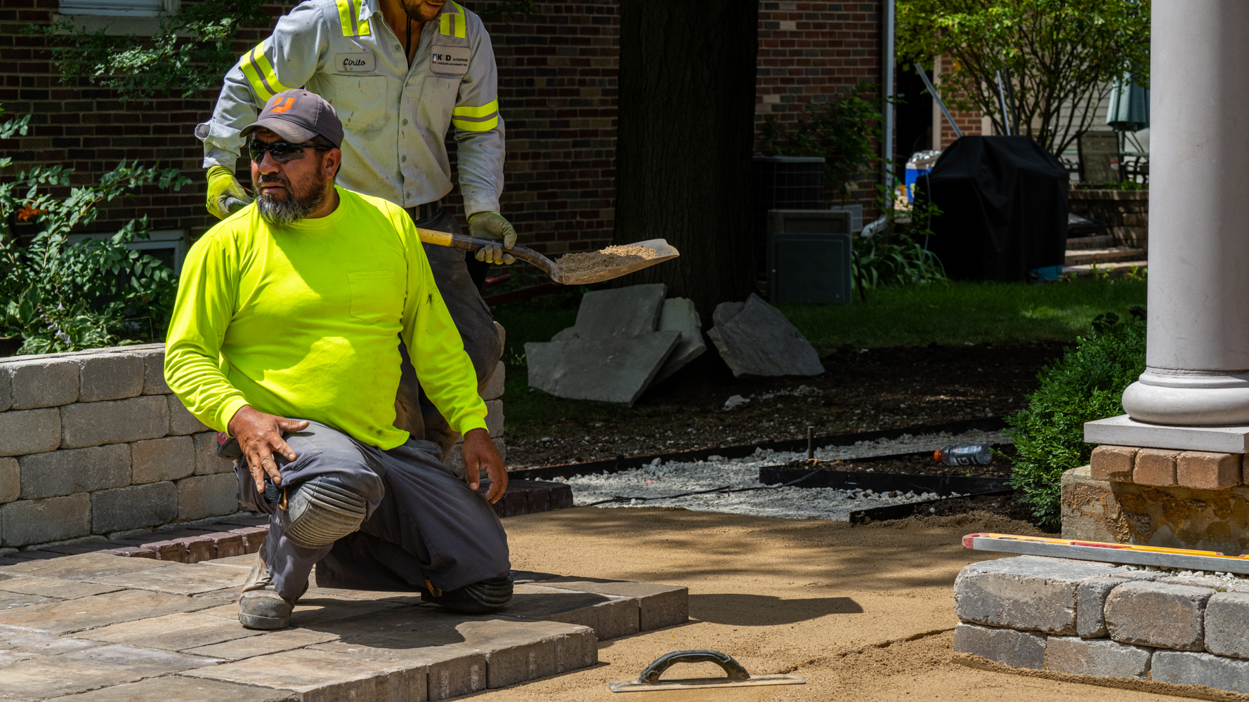 KD Landscape crew installing pavers