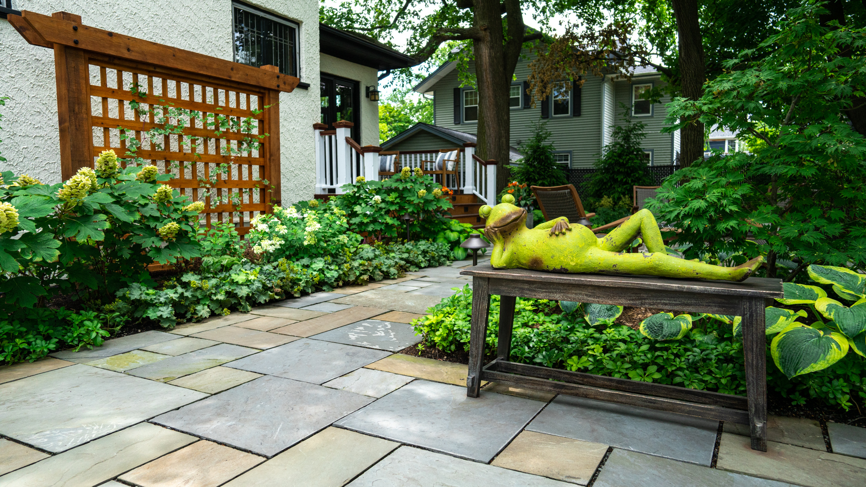 pathway-walkway-natural stone-pavers-sculpture-fire pit-fire feature-seating-planting-plants-hostas-shade-trellis-hydrangea
