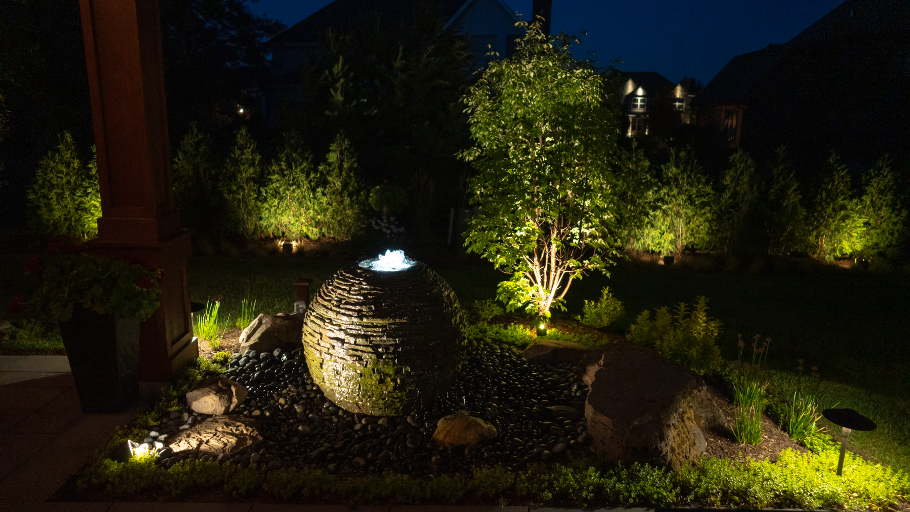 landscaping lighting around a water feature