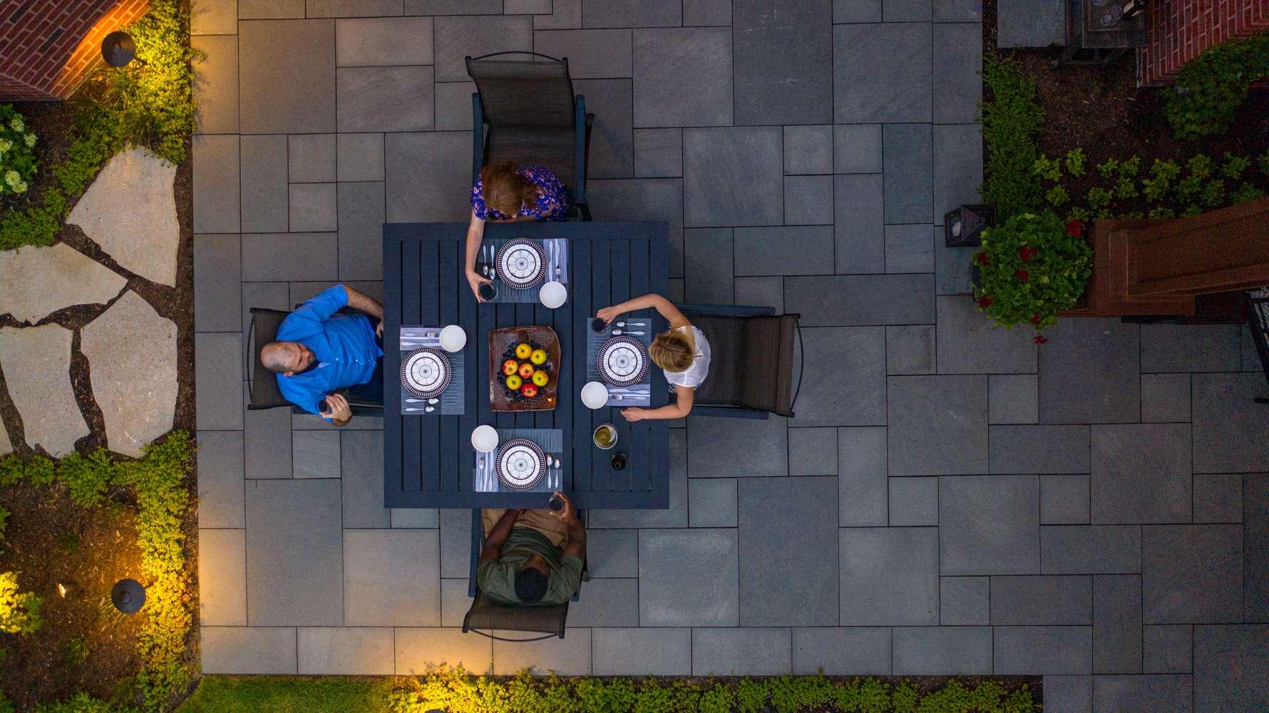 people enjoying dinner on bluestone patio